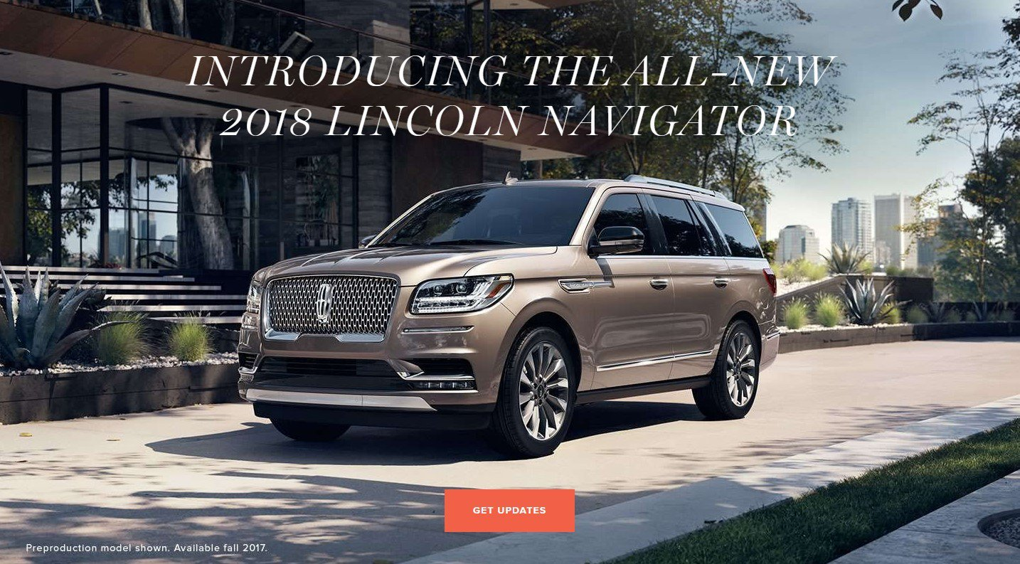 brown 2018 lincoln navigator parked out front our lincoln dealership